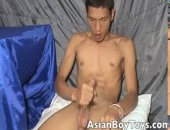 Sexual and handsome twink Cj wanking his massive cock on the couch