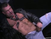 Leather stud Bruno Bond fingers himself while jacking off