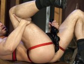Muscle hunk pleasures his asshole with some big rubber toys