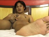 Cute stocky Ryan teases you with his super cute Asian boy feet seductively caressing them up close and personal and right in your face. Then he peels off his underwear and strokes up a boner for a while then squirts his creamy load all over his cute tummy.