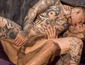 Damian on his back gets every inch of Freitas tattooed fury