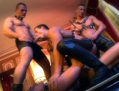 Four fetish guys wearing leather having sex on coffee table