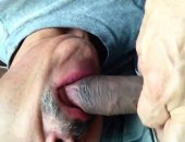 dude with a gray stache sucking a black cock