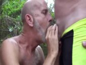 mature dude gives a bj to his buddy in spandex shorts