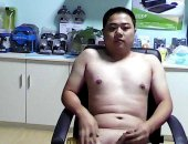 chubby asian jerks off in an electronics store