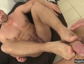 Guy gives footjob to a fat hard cock then gets it in his ass raw