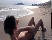 sexy Japanese twink shows off on the beach