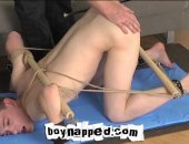 Another hot new comer to the Penthouse, rent boy Liam King falls for the idea that a visit to the penthouse would earn him a few quid. Bound with rope and wooden bars, Liam is unable to move from a position in which his ass stuck in the air begging to be fucked.
