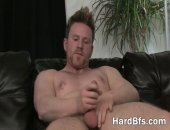 Handsome muscled man strips down and masturbates really hard on bed