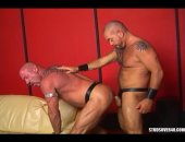 Scott Gable and Peter Moorr get straight into the action giving each other an oral 69 on the sofa. They both prove to be hungry cocksuckers, deepthroathing and tasting their daddy dicks with every inch of their mouth. The men love their leather as much as they love cock. Peters pierced chode and leather gear excites Scott as he works his pole deeper and deeper down his throat. Scott bends Peter over the sofa, licking his beefy ass as he grabs onto his ball sack. Scott fucks Peter over the end o