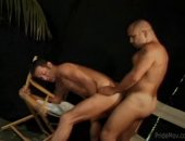 A sexy hunk shows off his perfect round ass and gets fucked doggystyle.