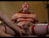 Bondage green gay boy tied in ropes on a chair while master gives him a handjob teasing him in masturbation sex video scene