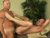 These mature men suck cock in the 69 position in the bedroom.