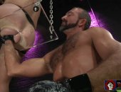 Hot stud tenderizes his friends ass hole through a hole !