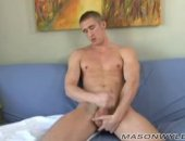 Mason Wyler strokes his hard dick and cums all over himself.