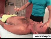 Tattooed gay getting hot body massaged well.