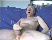 Middle aged man tugging cock