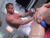 Toy in ass during hot massage from super stud who works over a body oiled up and presented to him for his personal pleasure