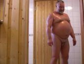 Soaping up his body after a sauna