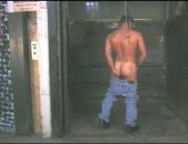 Jerking off in the back freight elevator where he usually works