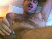 Big hairy dude masturbating and cumming