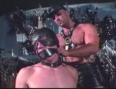 Hard BDSM action between two leathered up euro rivet heads.