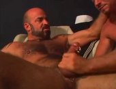 Bearded bear with a pierced cock fucks a submissive guy.