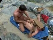 Two wilderness hunks enjoying each other in a mountain valley.