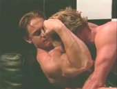 Getting off on the big muscles of his partner as he licks his nipples.