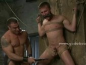 Guy is tied up and his cock painfully locked up before they start clipping his skin