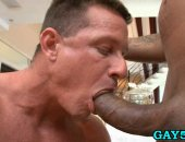 muscular hunk blows massive black cock