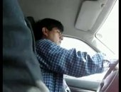 Jerking off next to a taxi driver in his car