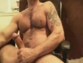 Sexy tattooed muscle bear masturbating and cumming