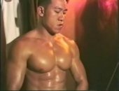 Hot sexy muscular oiled up Asian jerking on cam