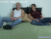 Pair of straight guys sit on bed near and pose you expect for something interesting.