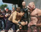 A red head stud is stripped naked and humiliated in public.