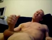 Horny young white male stroking his cock on video