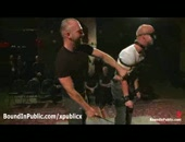 Baldheaded and blindfolded bound muscle gay stripped and flogged by master and fucked in mouth by other gays in gay night club