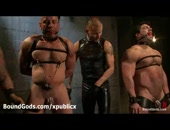 Two gagged and bound muscle gays gets submitted by two other gay masters in leather in dungeon