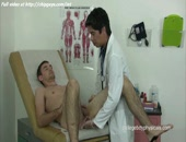 Sexy medical guy is pushing small white dildo into fresh shaved ass of naked patient on couch.