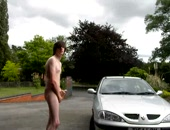 A brit boy wanking in a driveway near a car with his cute cock.
