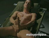 More scenes of marines in action lead us to Rex Ruben beginning to bed down for the night. He is glad to be alone. After messaging his feet he crawls under the blanket with his flashlight and talks to his cock.