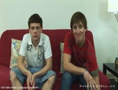 Couple sweet twink guys relaxing and posing excited bodies on sofa.