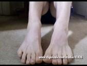 Cute guy showing big smooth feet on webcam.