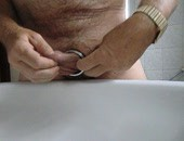 Amateur Cock Ring - put on my cock ring an took a piss at home