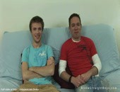 Two sexy guys posing and relaxing on a sofa getting comfortable
