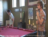 Have good mood two cool college boys are playing pool.