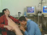 Two young guys get it on at the computer on webcam.