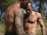 Two gay hunks hook up outdoors