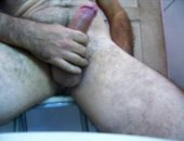 Hot cum drips down his hairy leg. Stroking his cock furiously until that sticky finish!